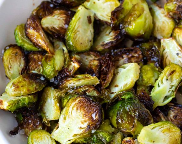 crisp browned air fryer brussels sprouts served in a white dish