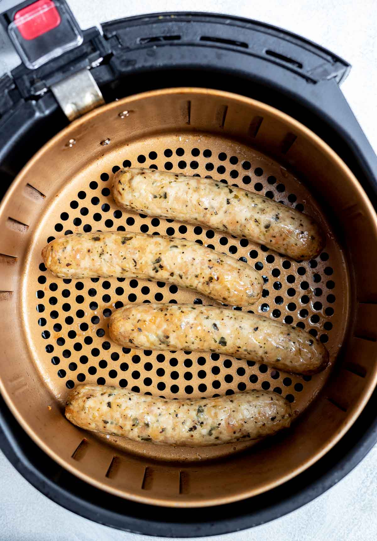 air fryer sausage in fryer basket