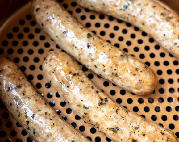 air fryer sausages in fryer basket