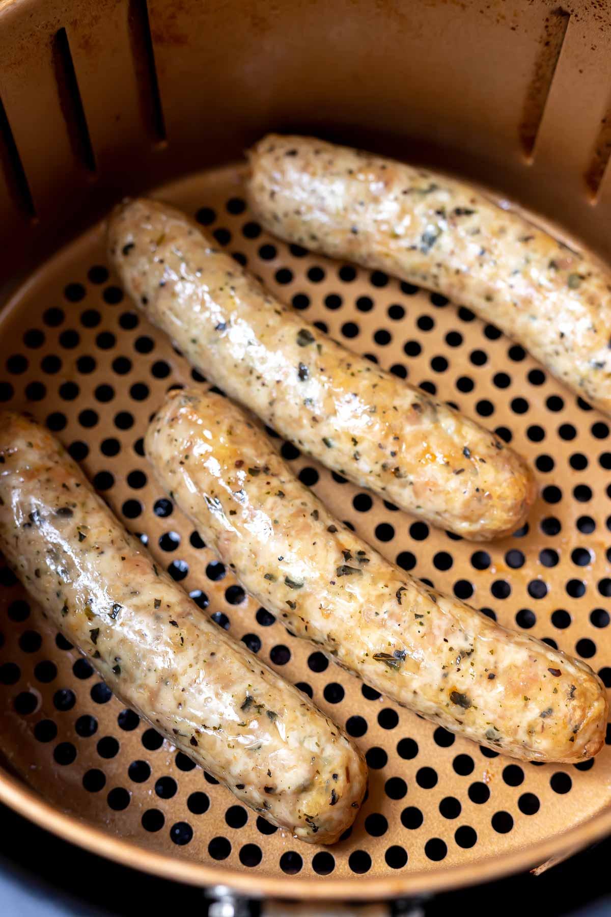 air fryer sausages in fryer basket