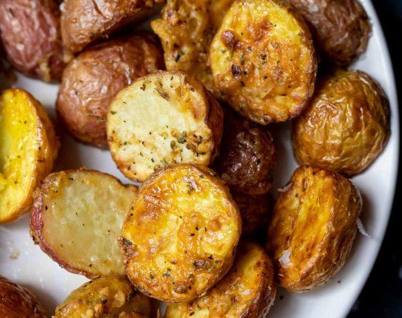 crispy air fryer parmesan potatoes served on a white plate