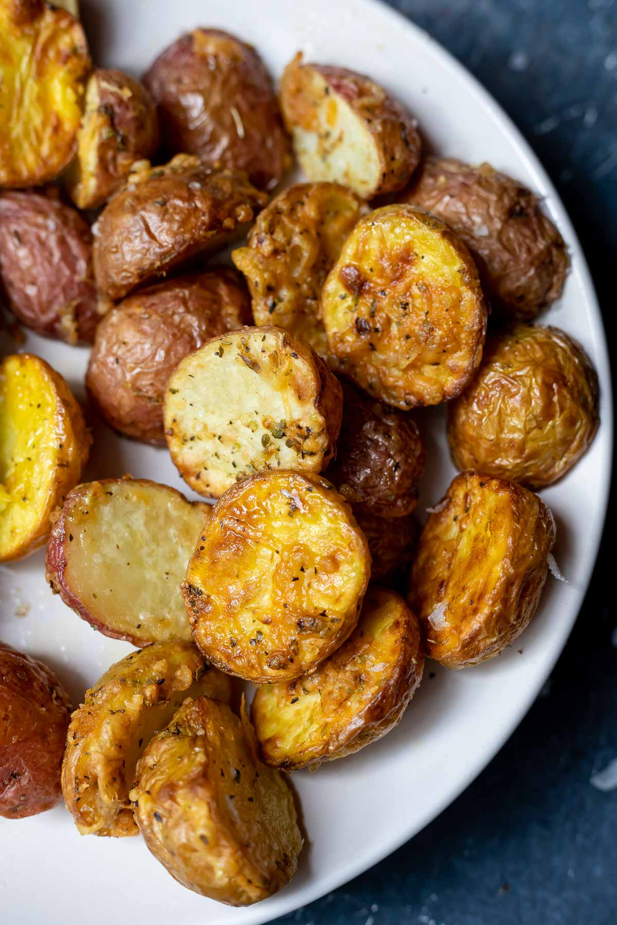 crispy air fryer parmesan potatoes served on a white plate