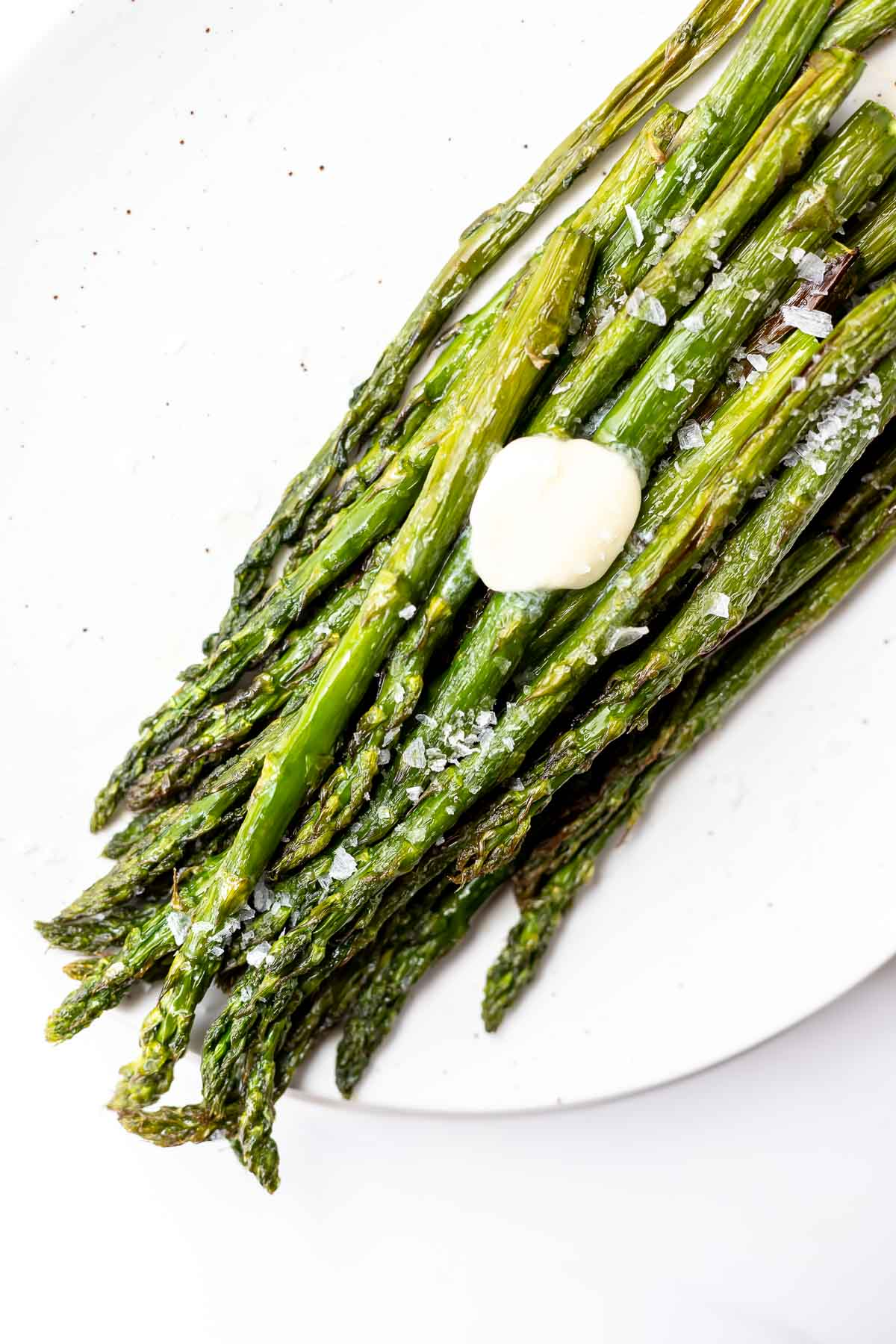air fried asparagus on white plate