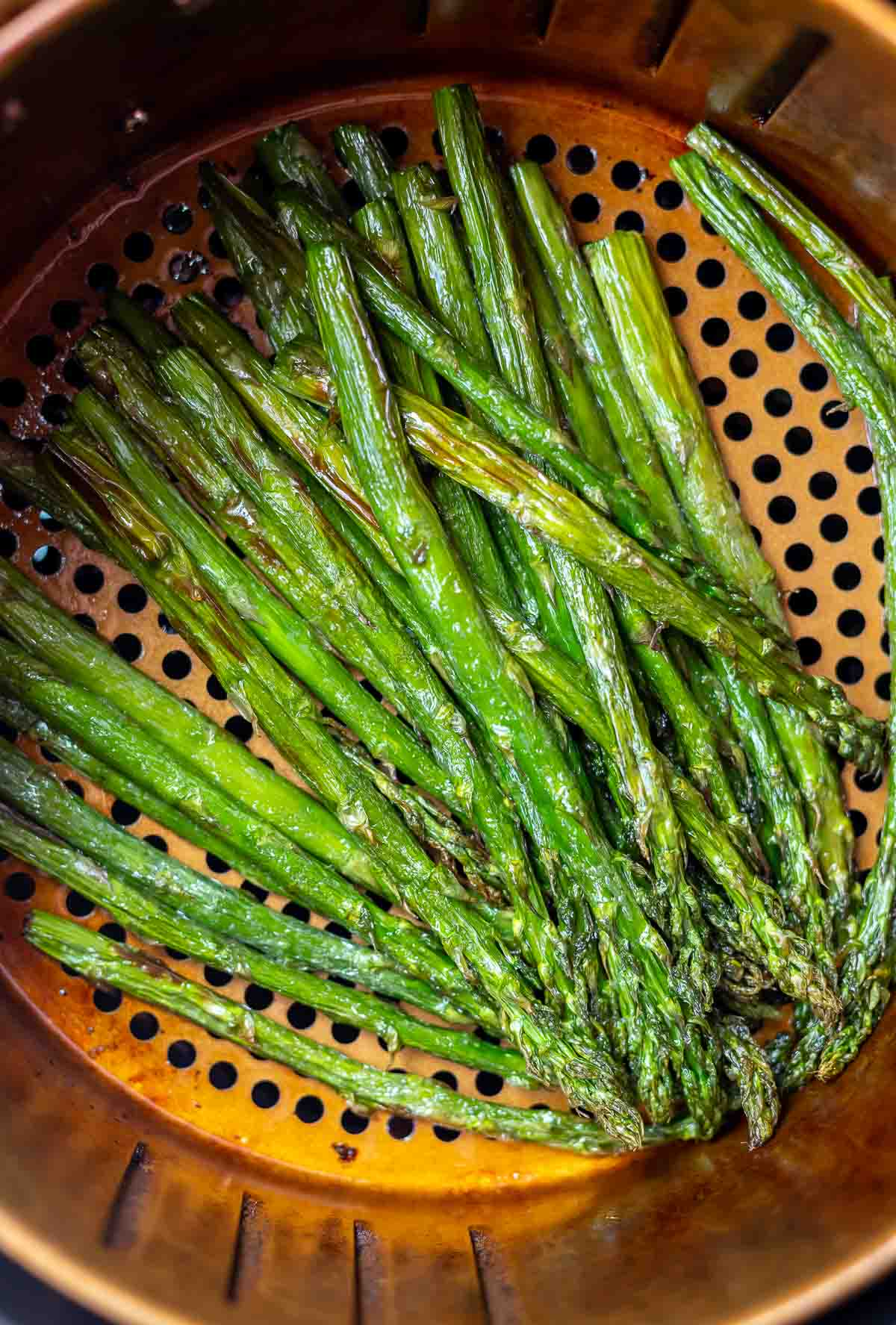 roasted air fried asparagus in air fryer basket