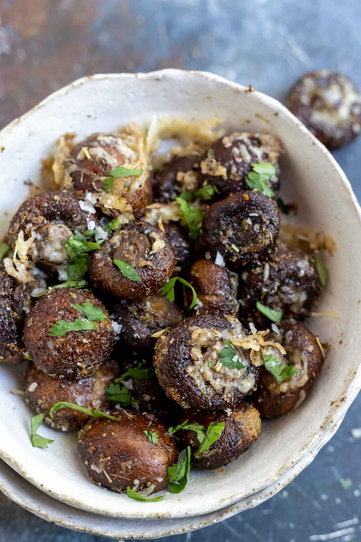 air fried mushrooms with parmesan and parsley in white serving bowl