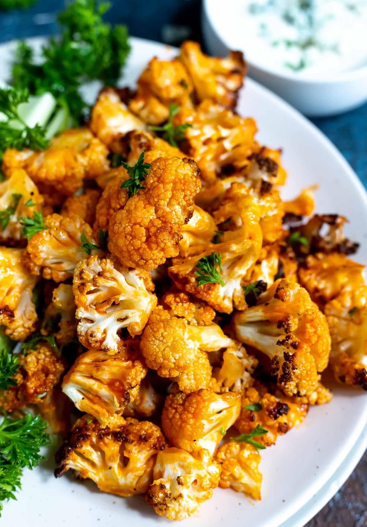 air fried buffalo cauliflower on white plate