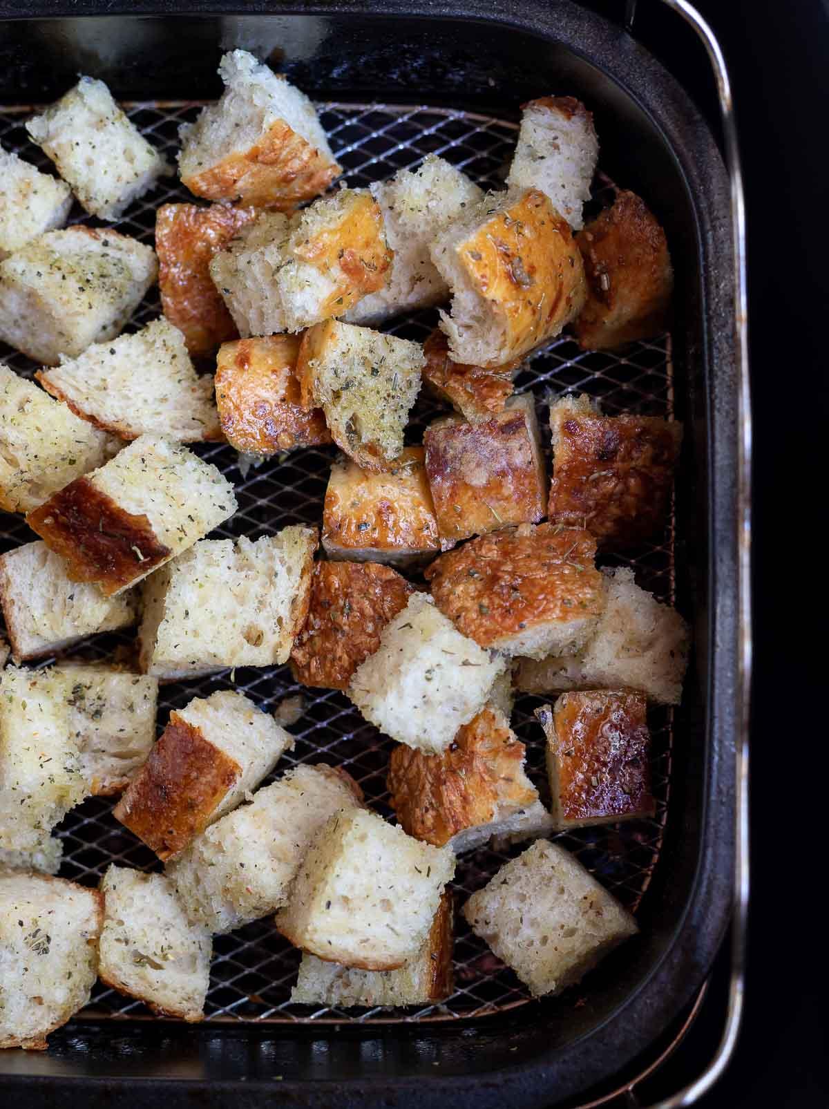 cubed bread in air fryer basket