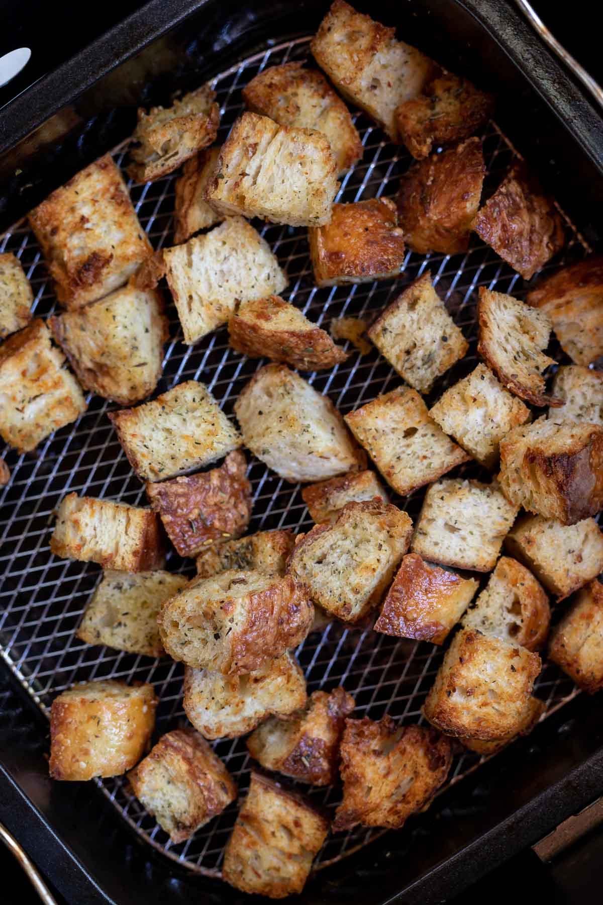 golden brown croutons in air fryer basket