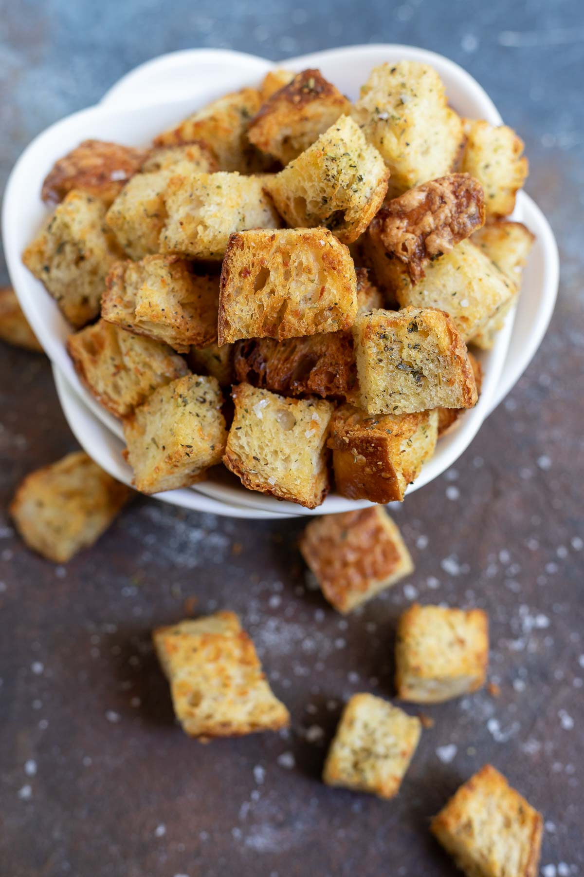 golden air fried croutons in white bowl