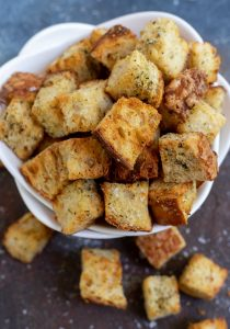 air fried croutons in white bowl