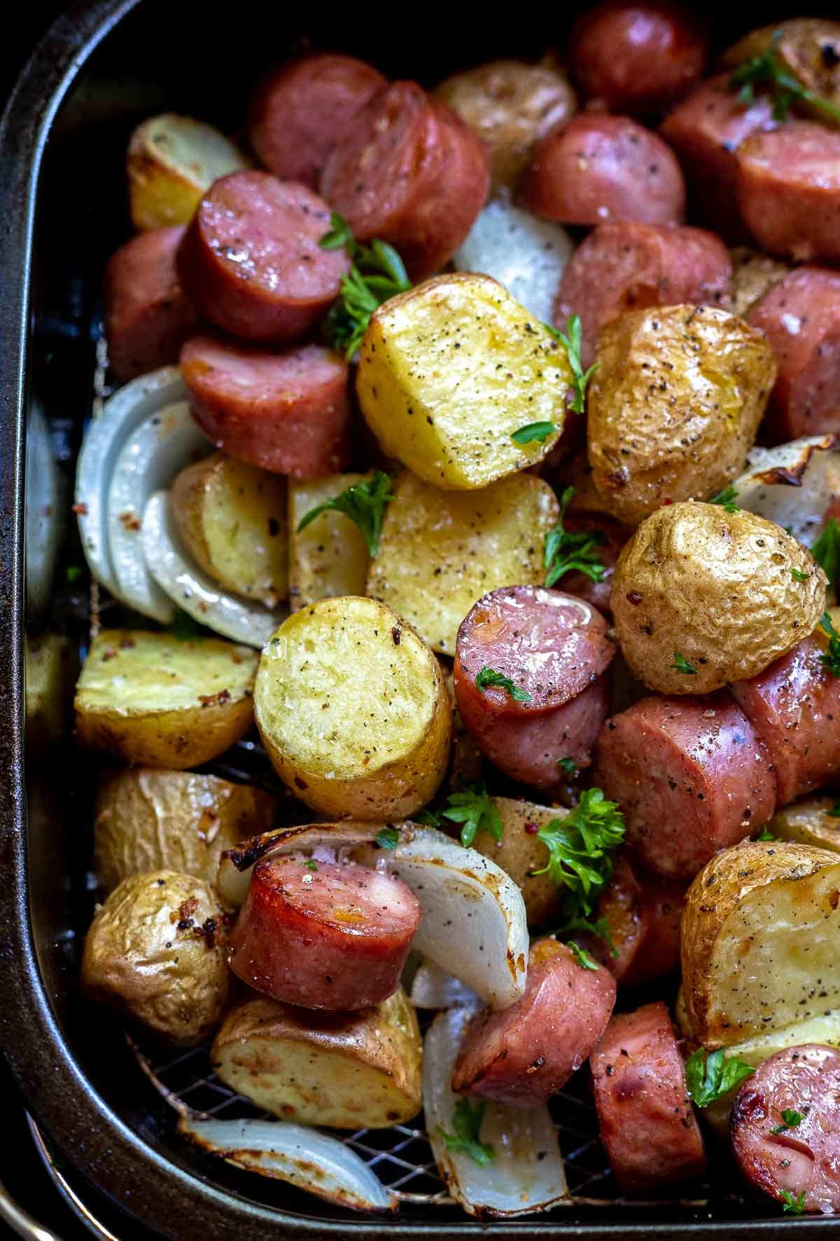 potatoes, sausage and onions in air fryer basket