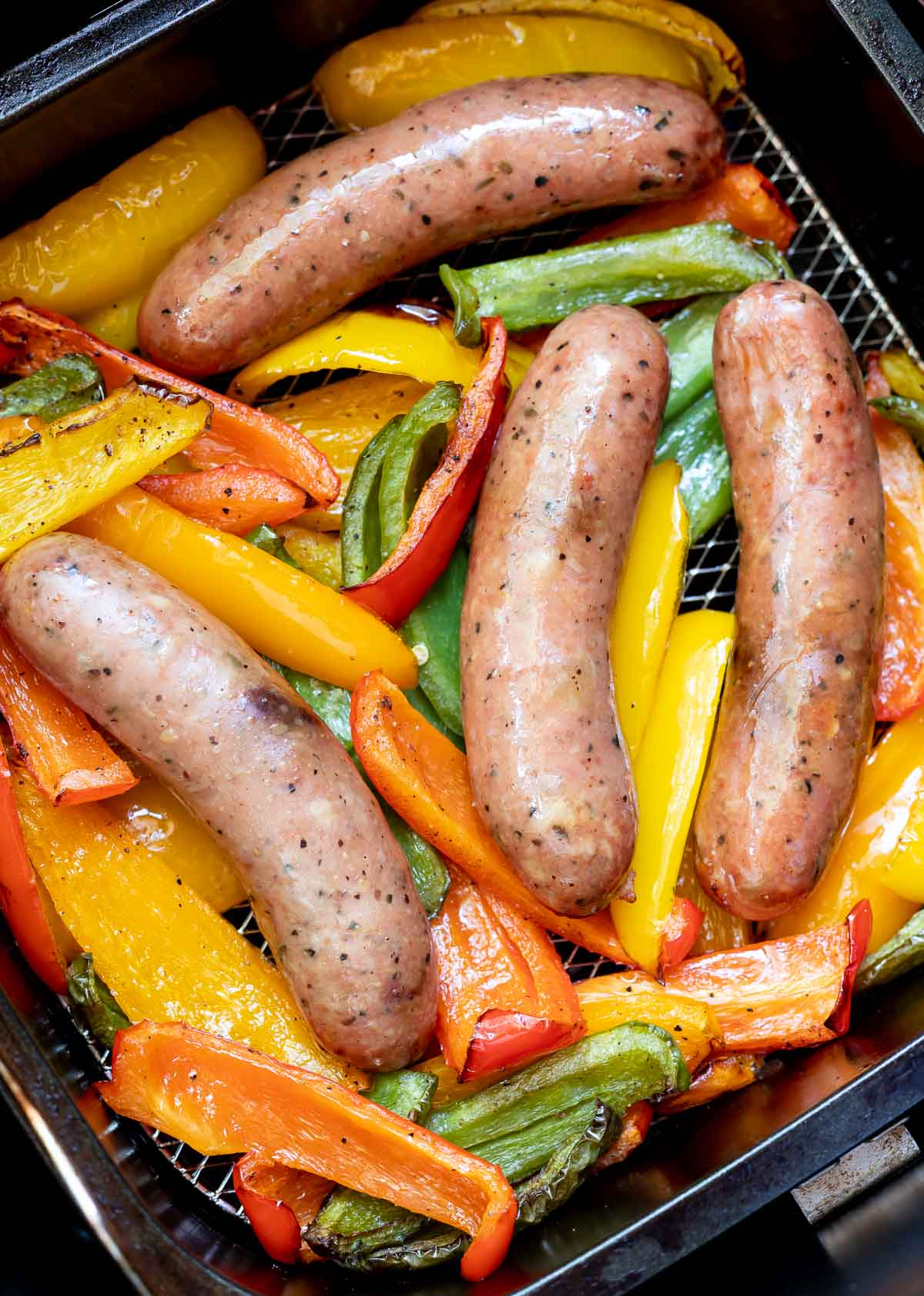 sausages and peppers in air fryer basket