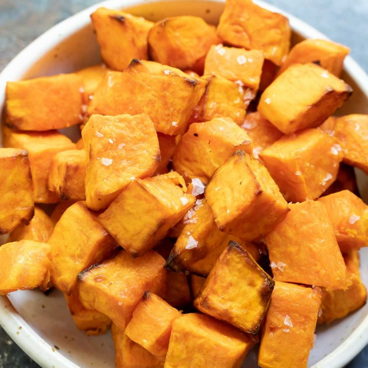 roasted sweet potato chunks in white bowl