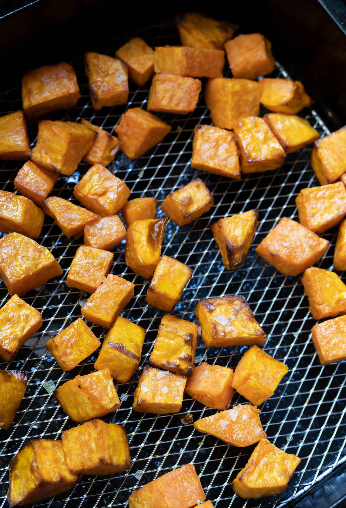 roasted sweet potato chunks in air fryer basket