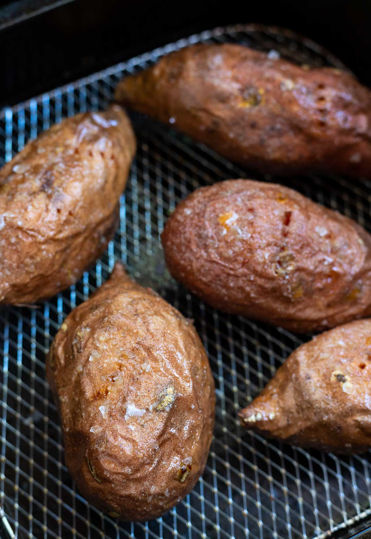cooked sweet potatoes in air fryer basket