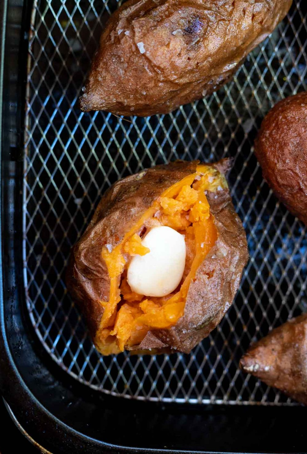 sweet potatoes filled with butter in air fryer basket