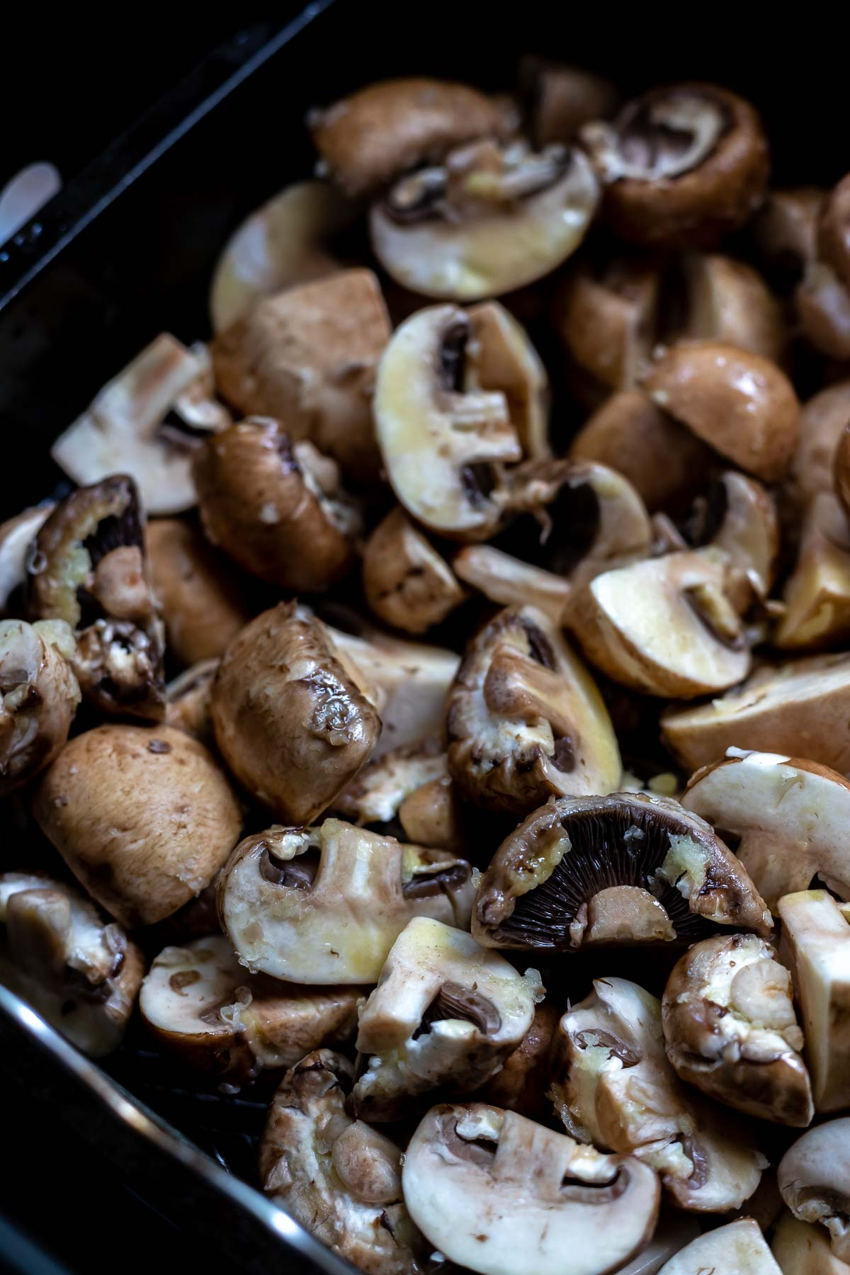 raw mushrooms in air fryer basket