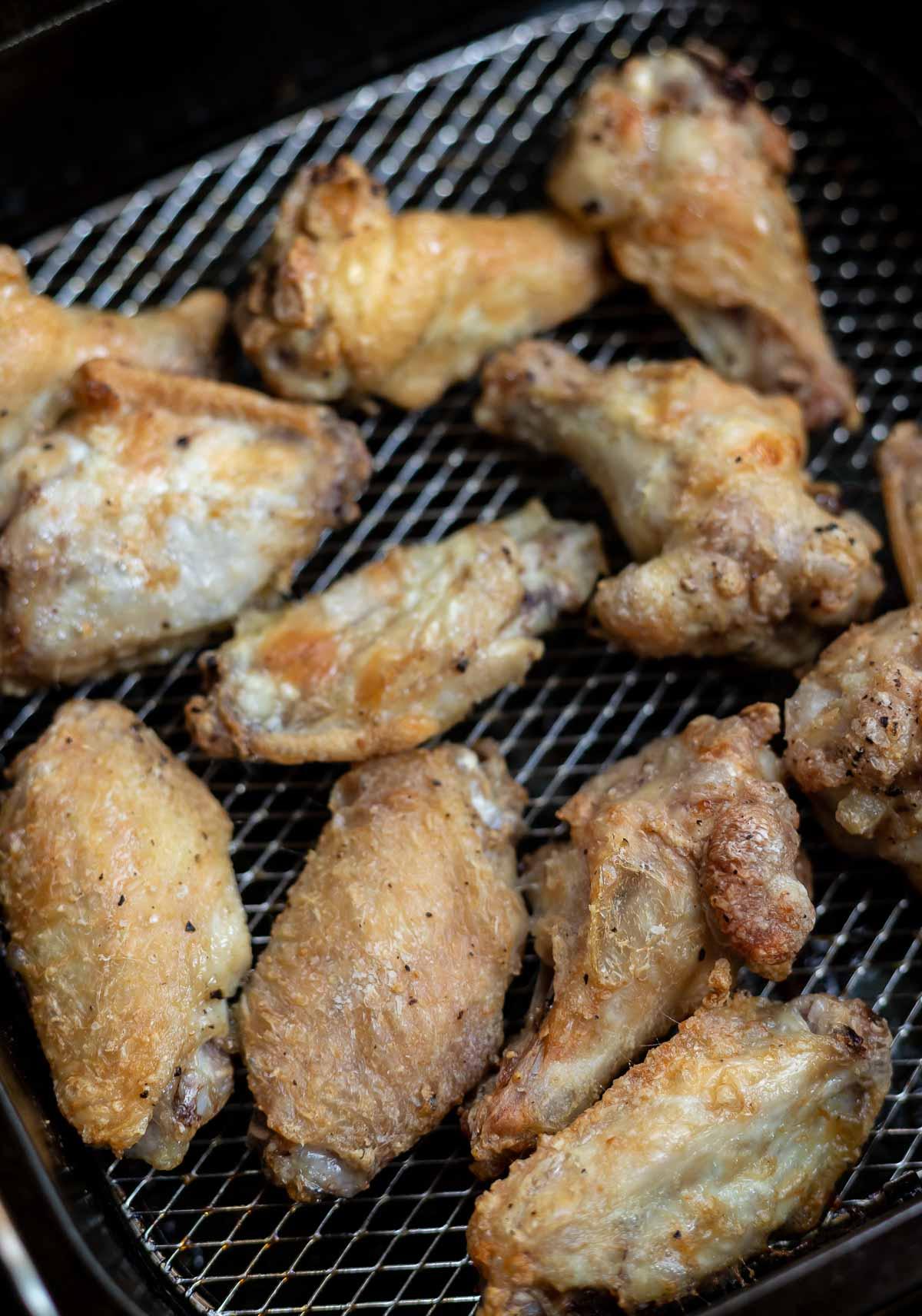 crispy chicken wings in air fryer basket