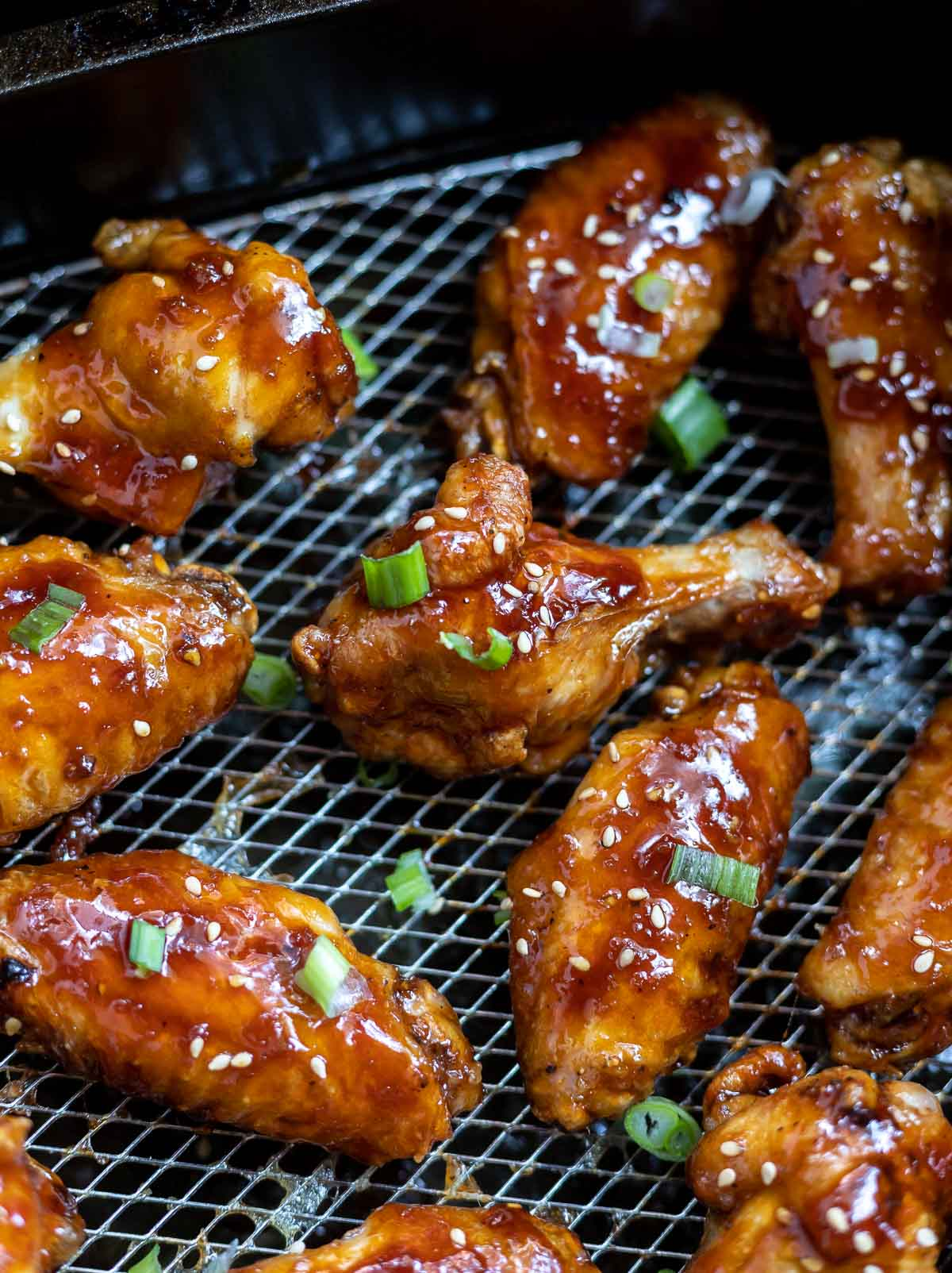 chicken wings with teriyaki sauce in air fryer basket