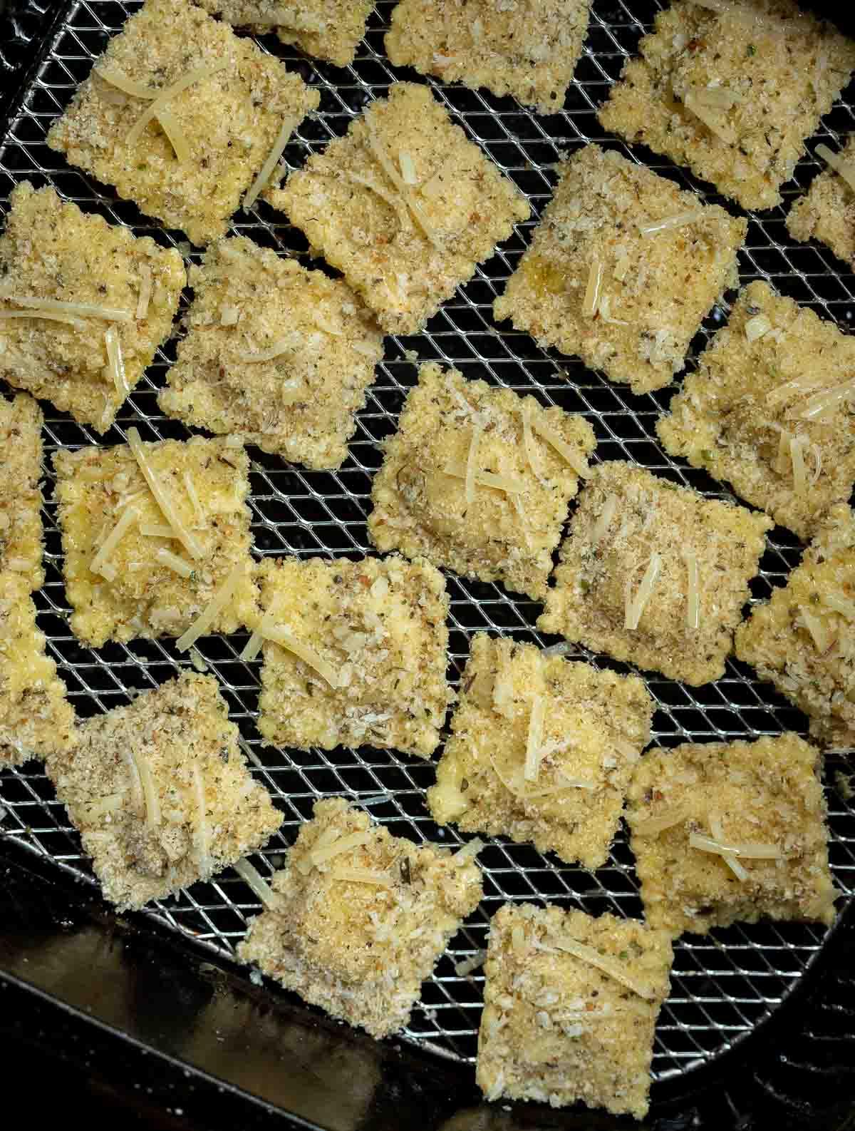 uncooked ravioli in air fryer basket