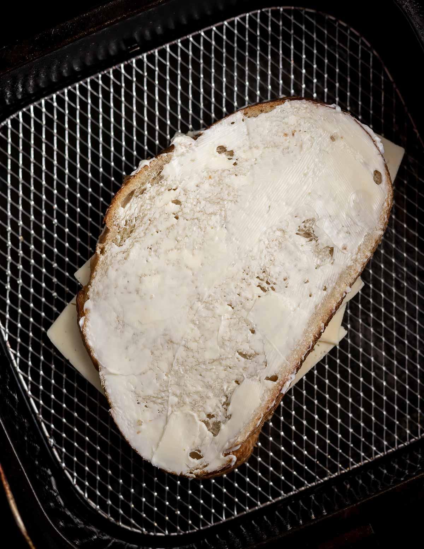 prepared sandwiches Wirth buttered bread in air fryer basket