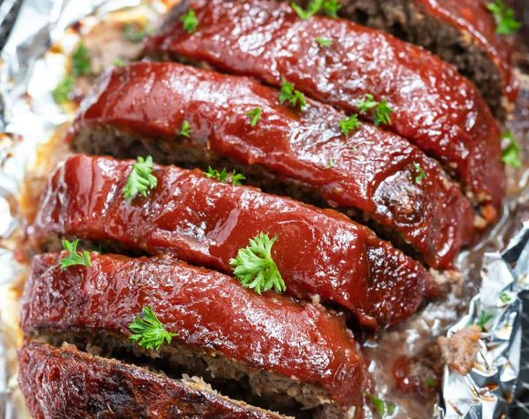 sliced meatloaf over tin foil in air fryer basket