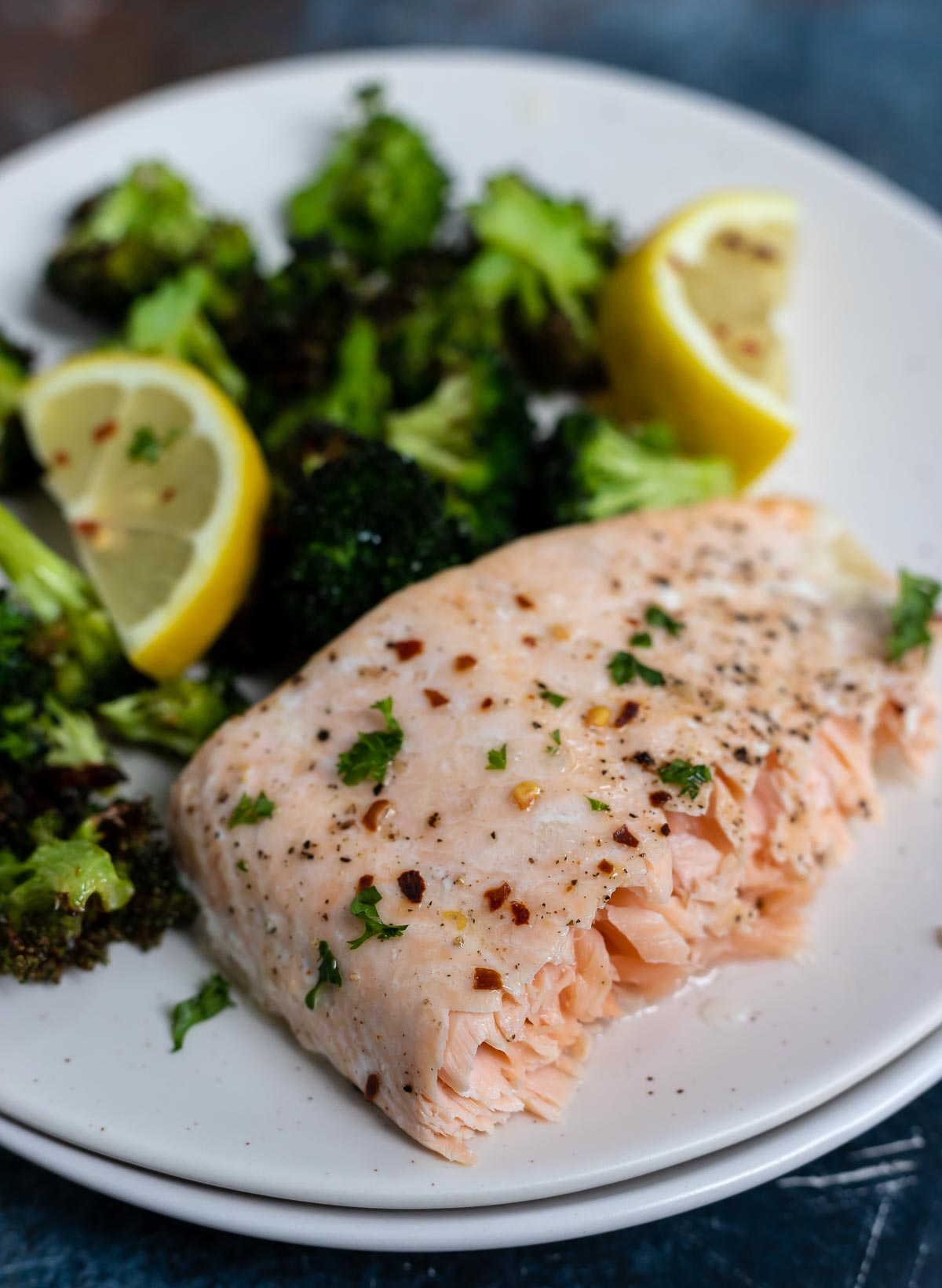 air fried salmon with broccoli on white plate