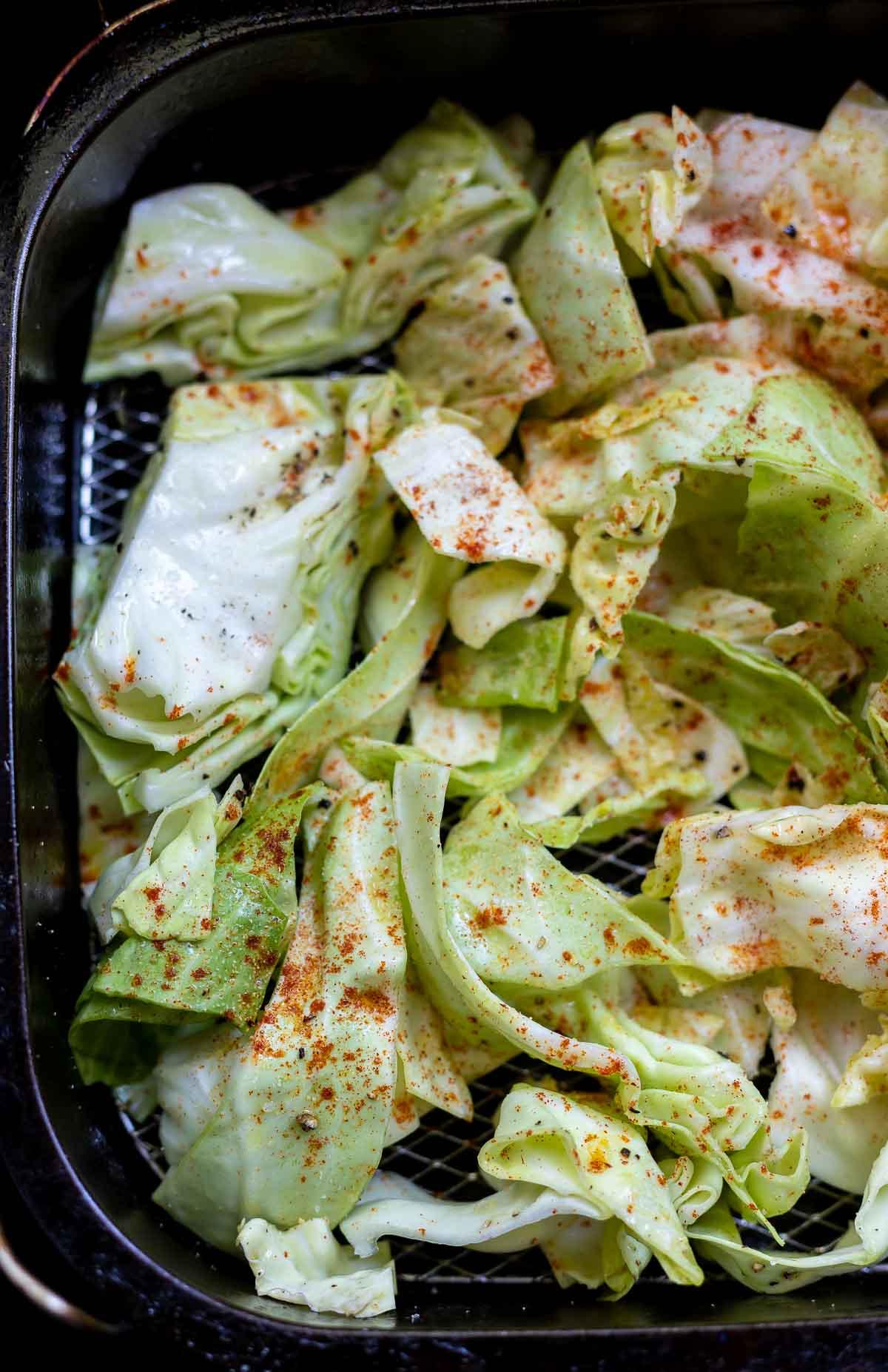 raw cabbage in air fryer basket