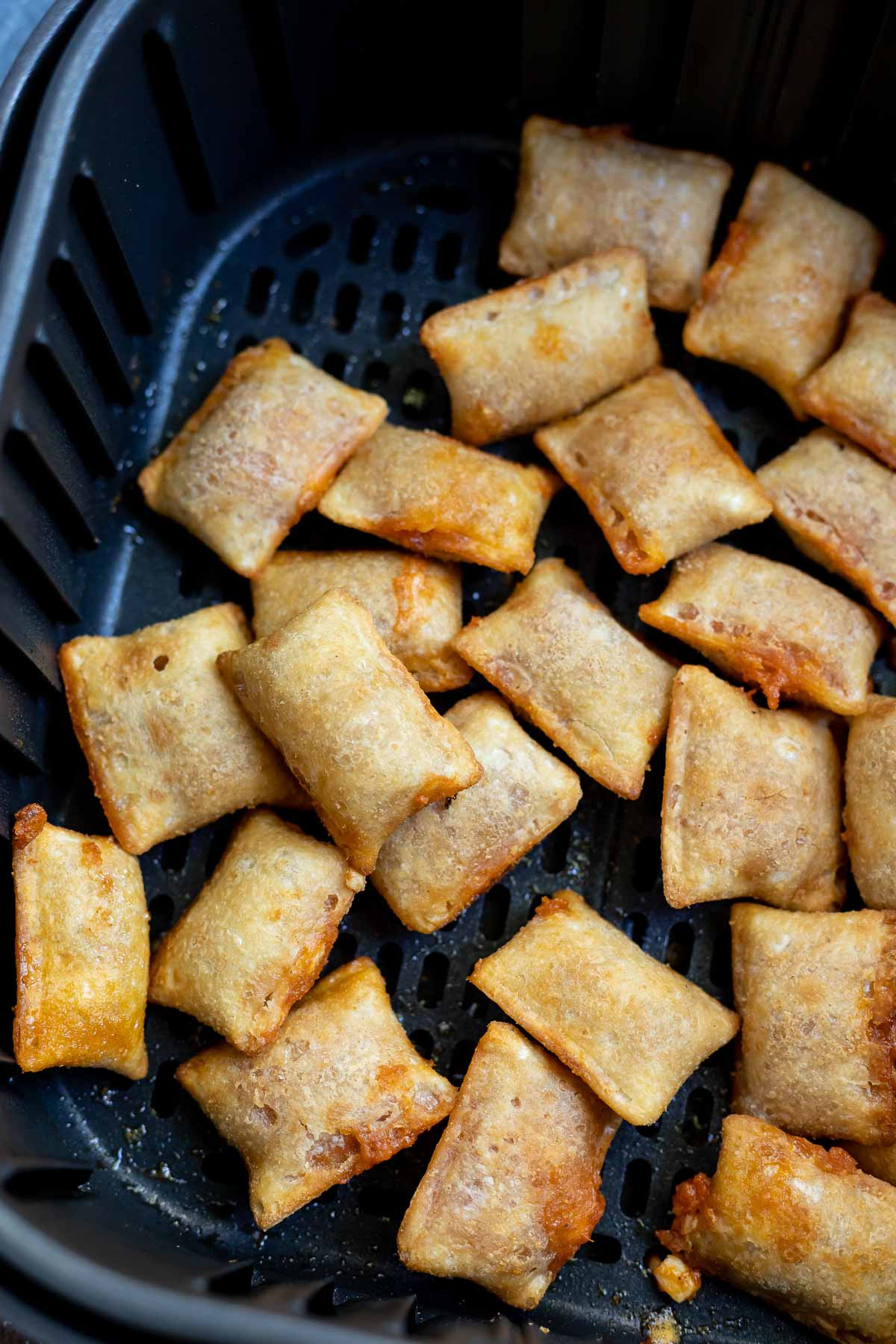 cooked pizza rolls in air fryer basket