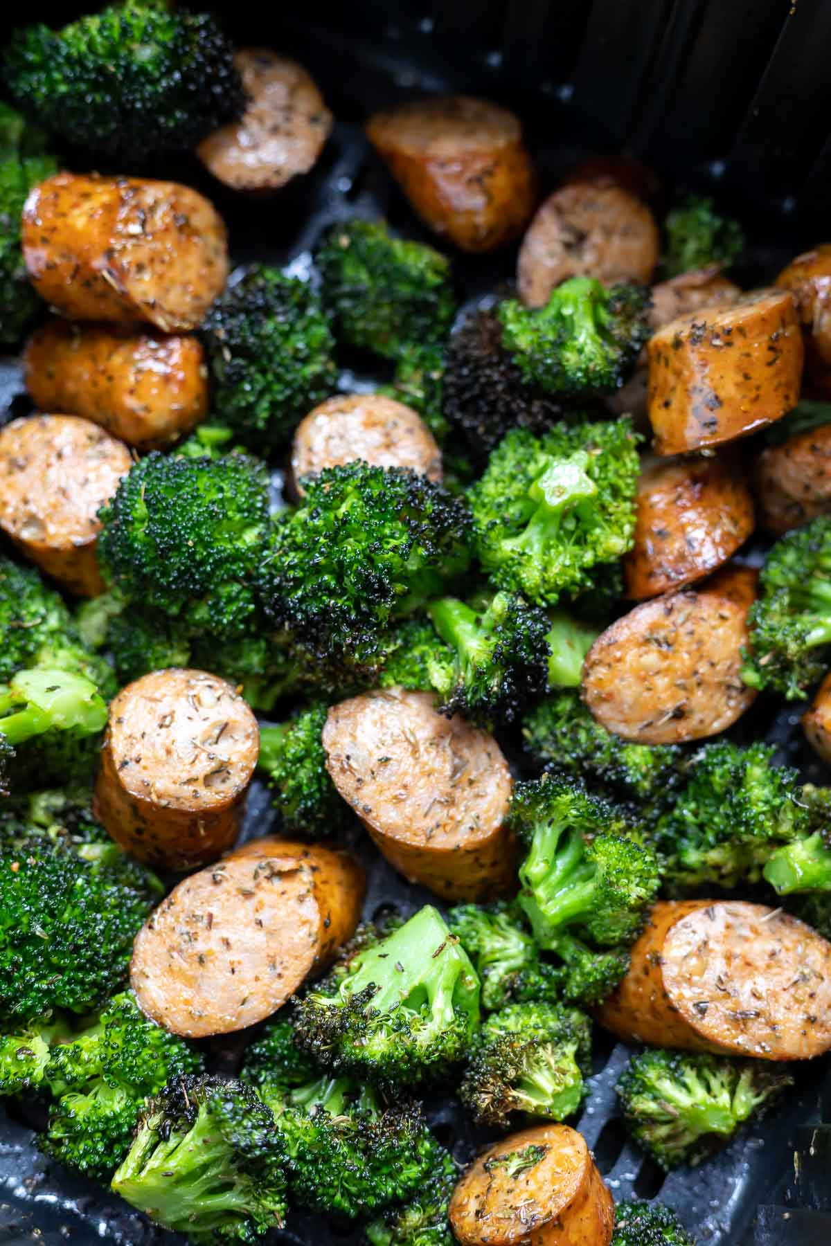 cooked sausage and broccoli in air fryer basket