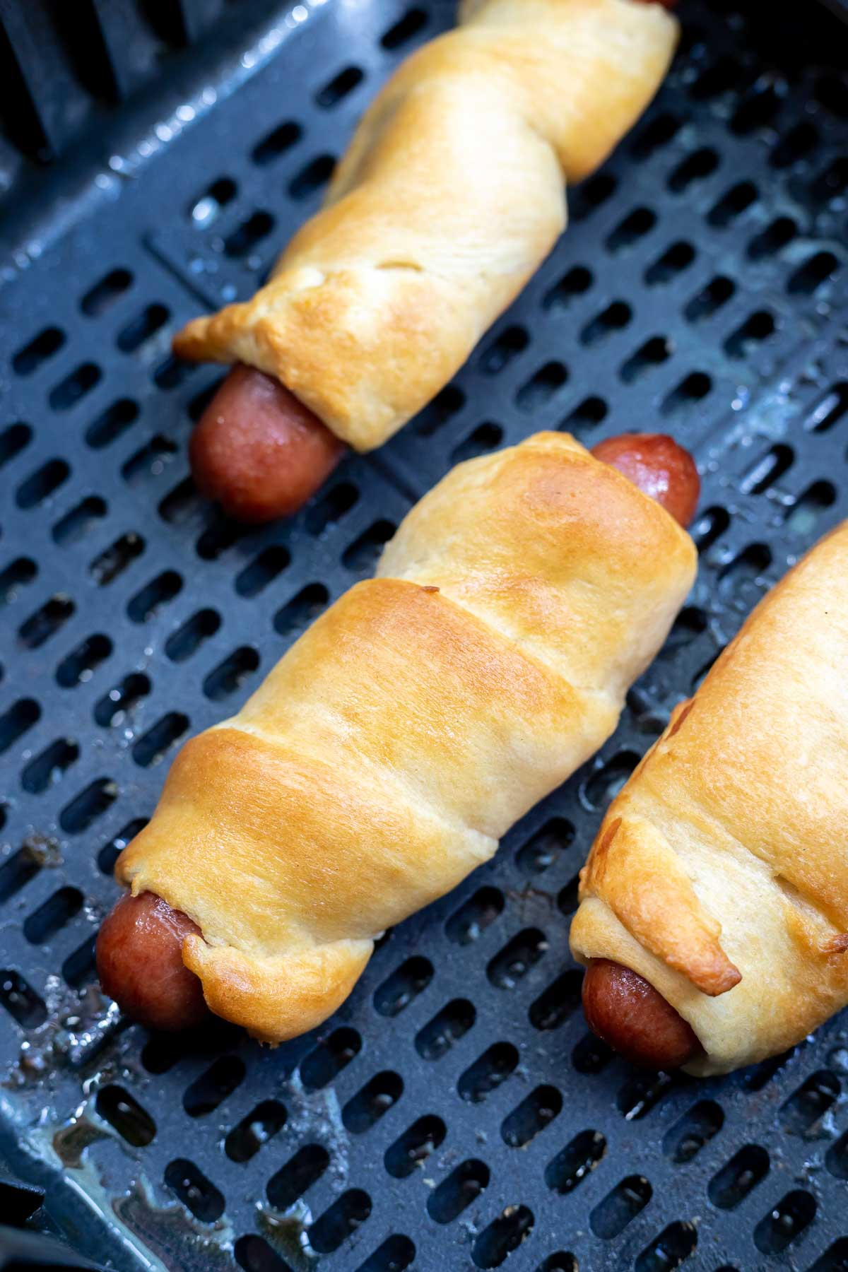 cooked crescent dogs in air fryer basket