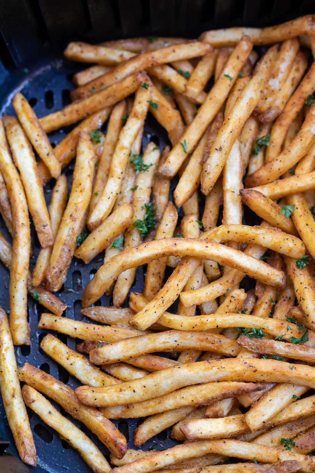 cooked French fries in air fryer basket