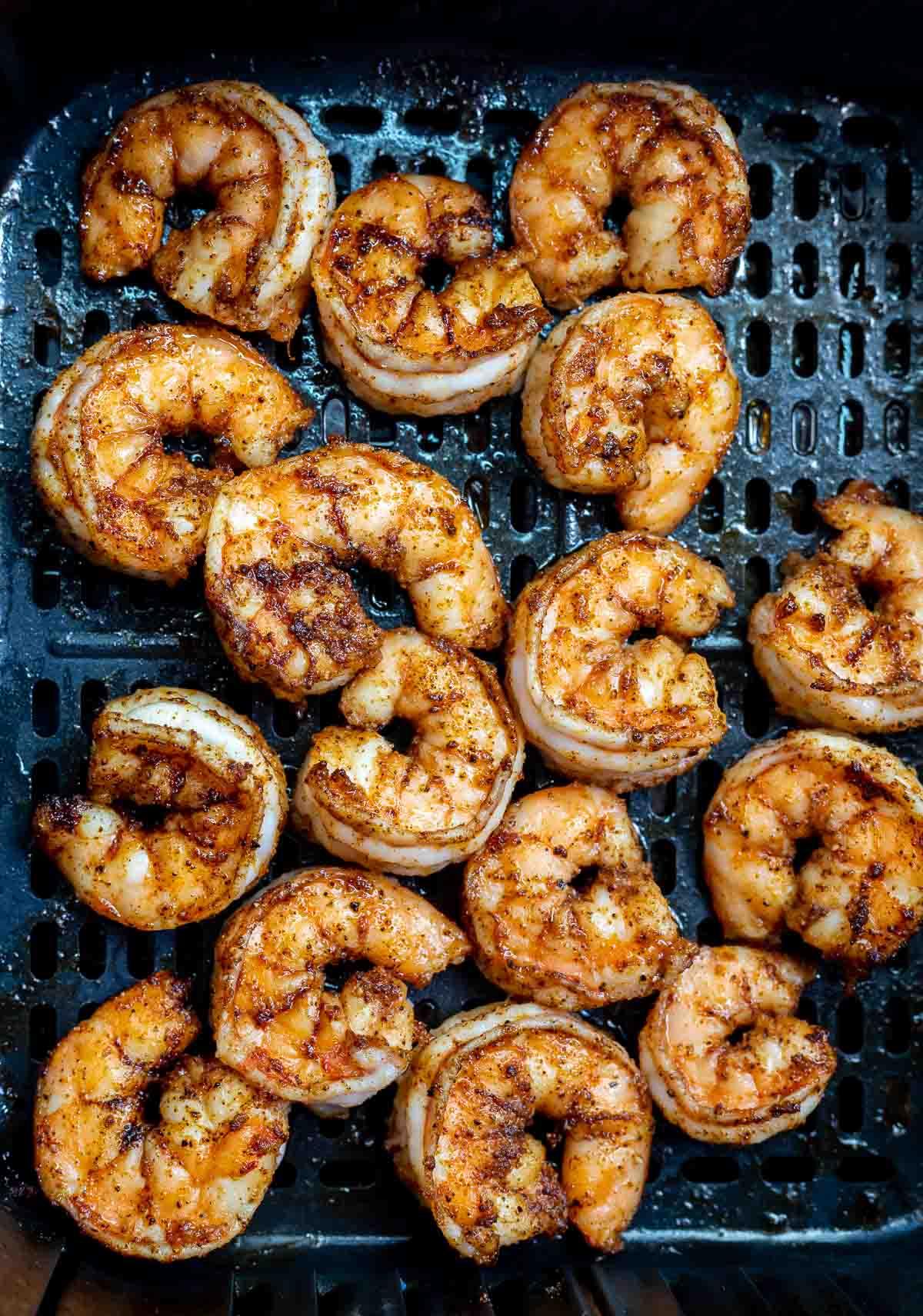 cooked spiced shrimp in air fryer basket