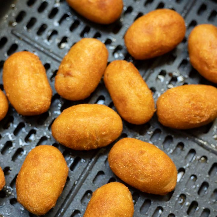 cooked mini corndogs in air fryer basket