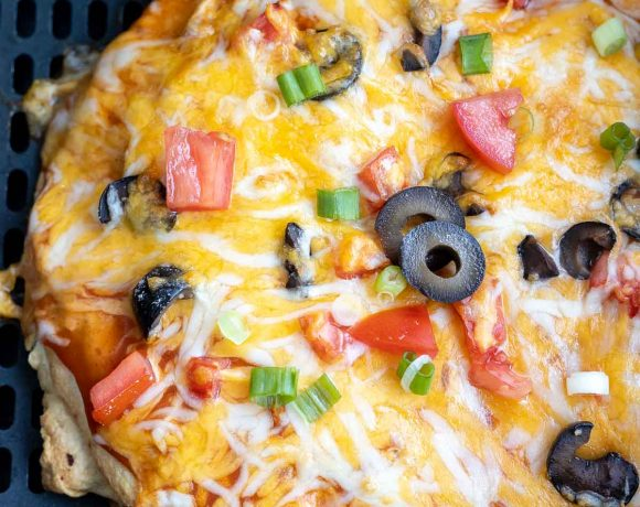 cooked Mexican pizza in air fryer basket