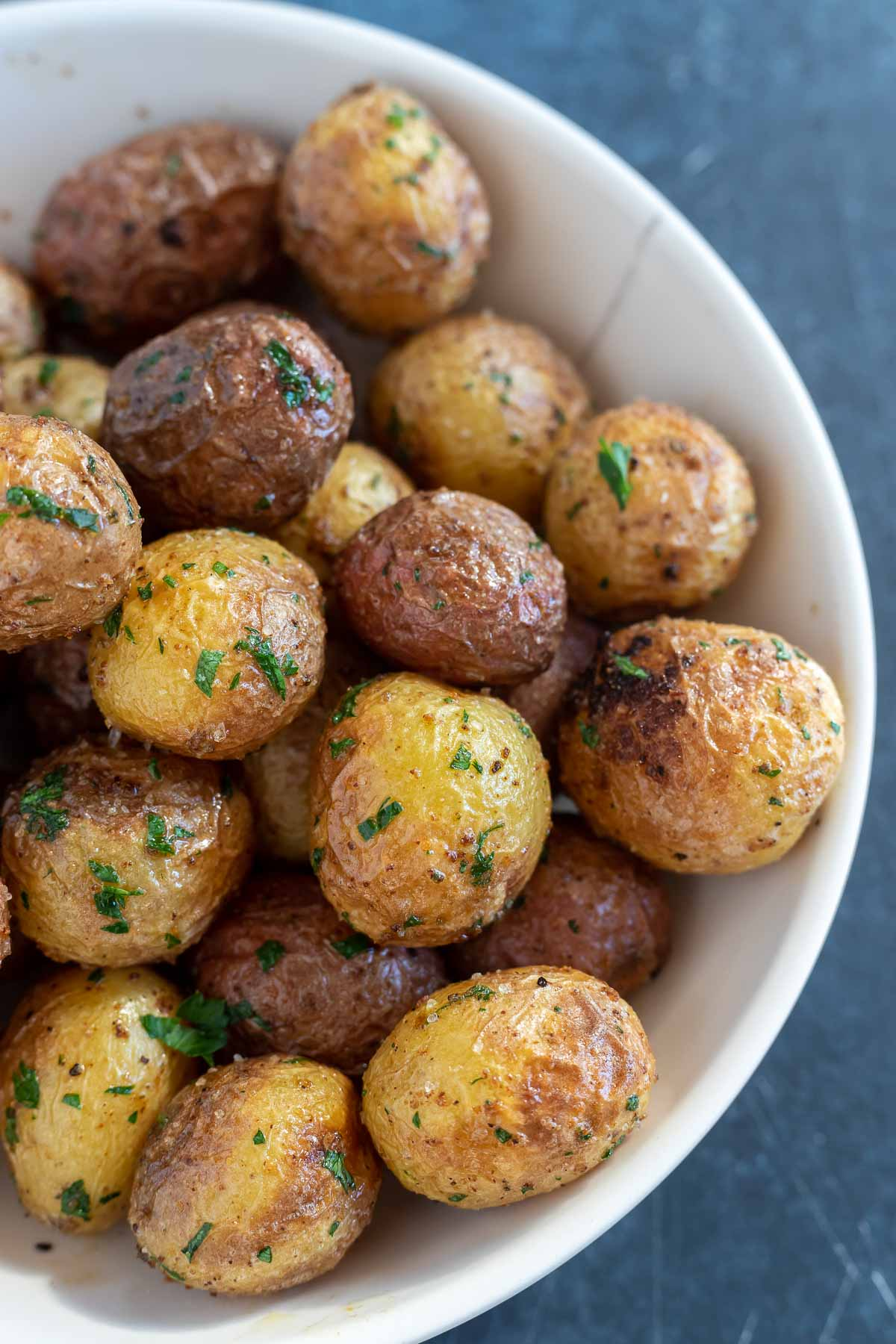 cooked baby potatoes in white bowl