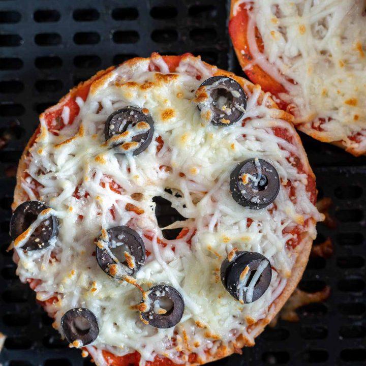 cooked bagel pizzas in air fryer basket