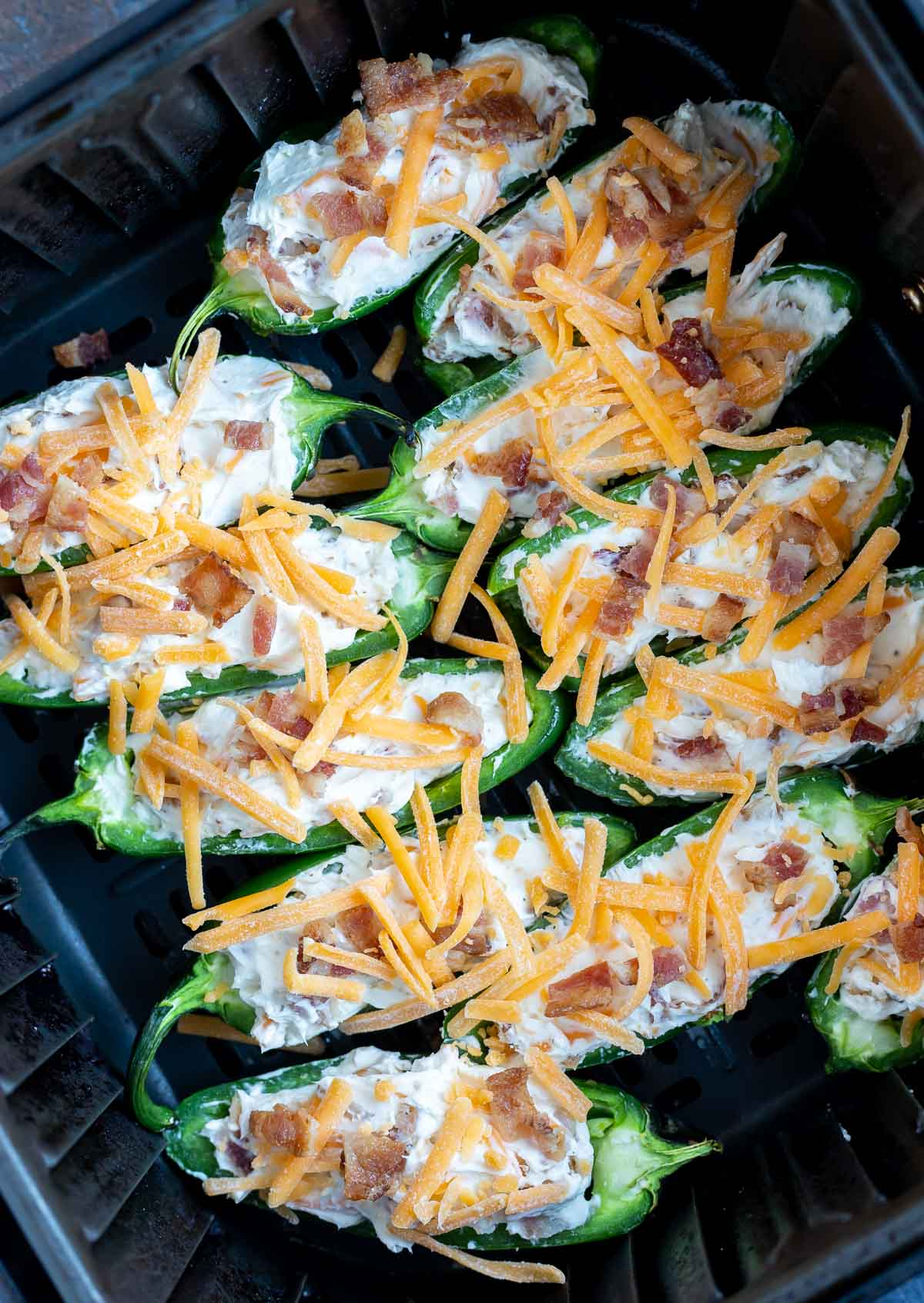 uncooked jalapeno poppers in air fryer basket