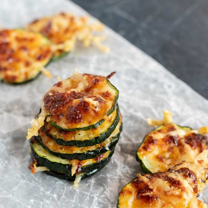 stacks of air fried zucchini chips on wax paper