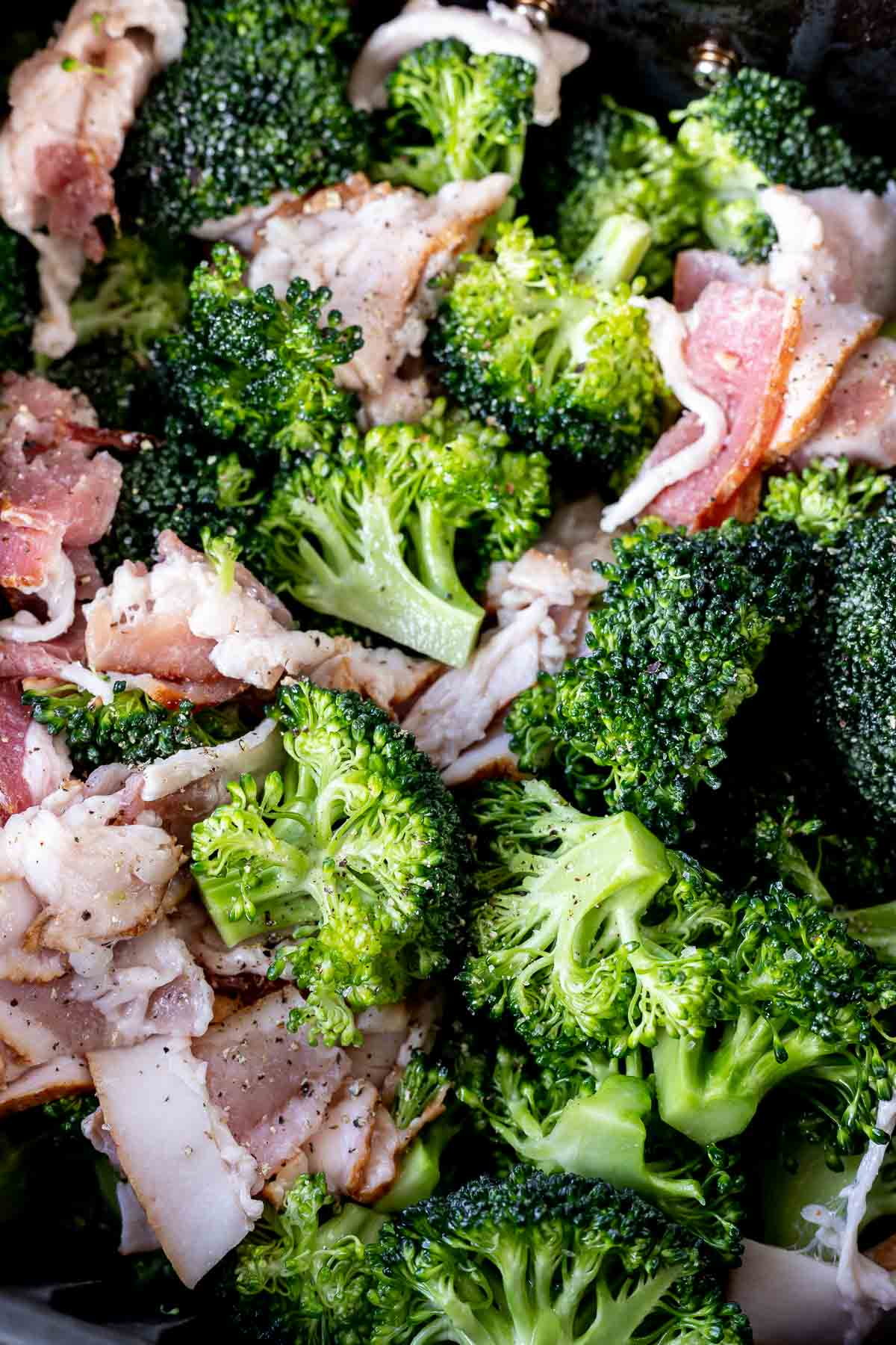 raw broccoli and bacon in air fryer basket