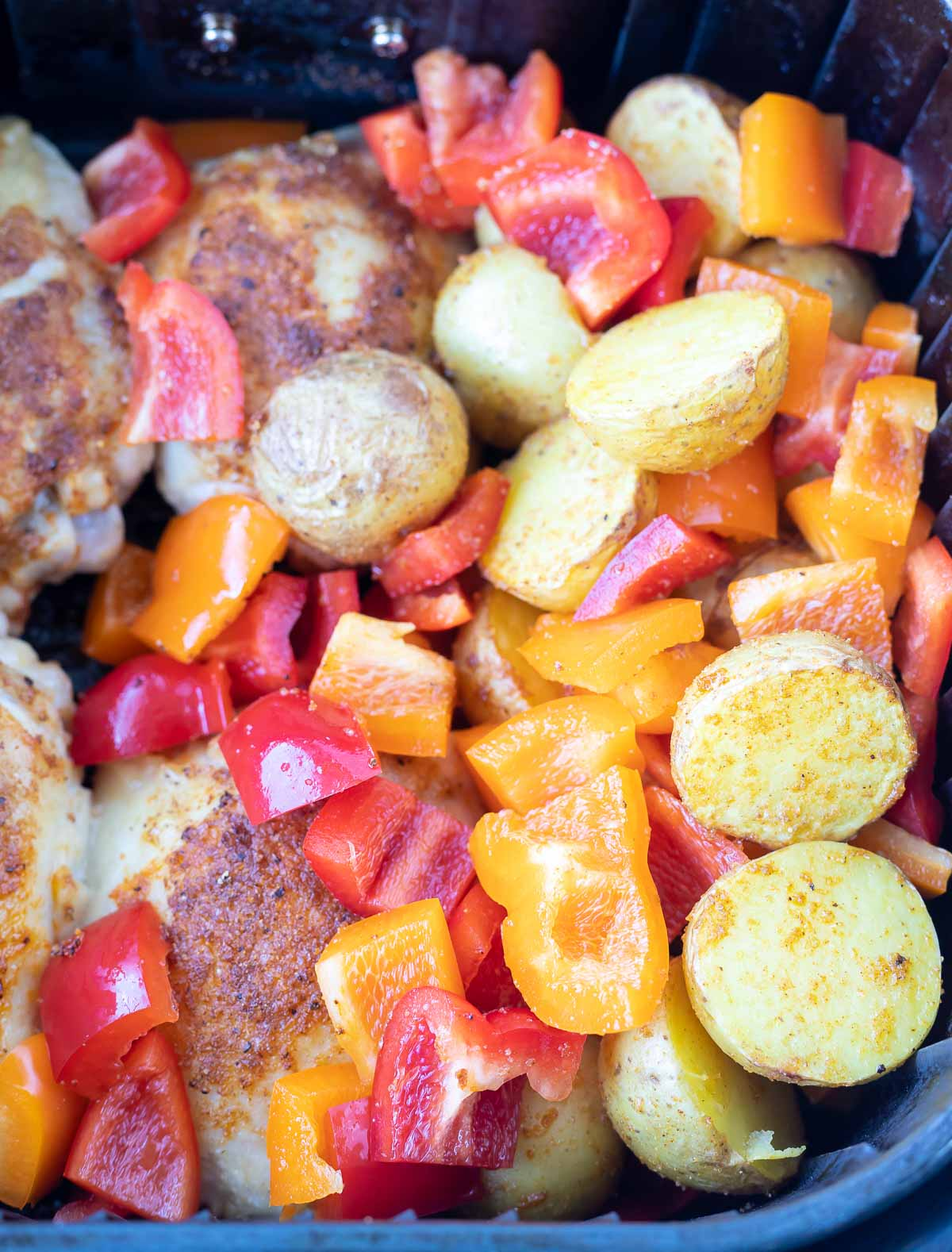 chicken potatoes and peppers in air fryer basket