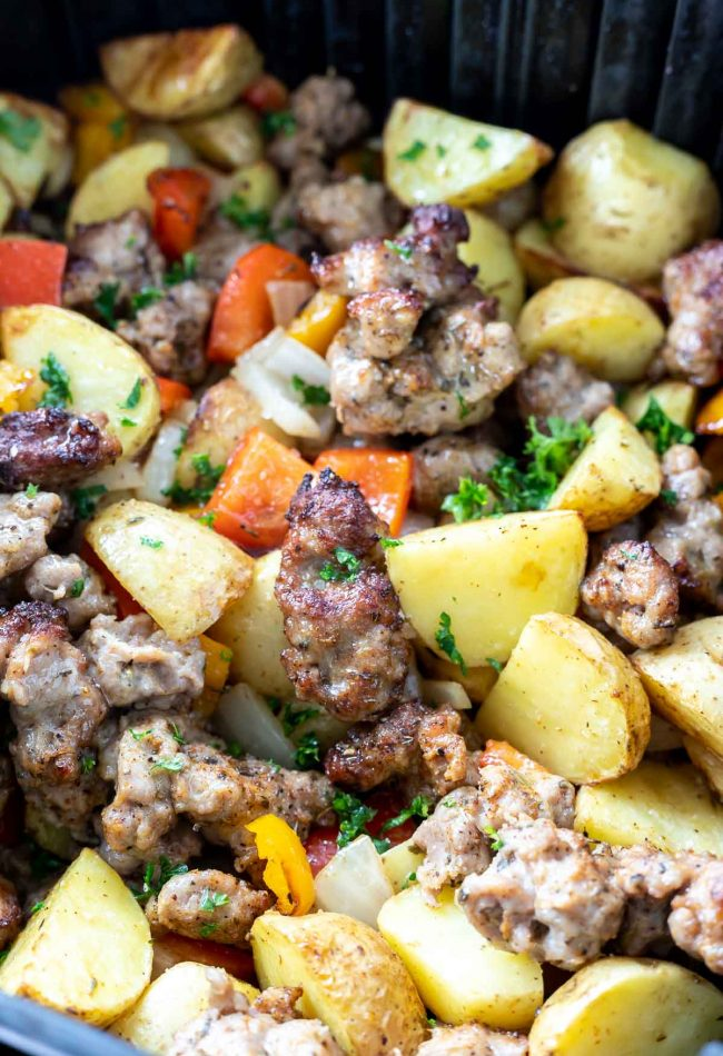 sausage potatoes and peepers in air fryer basket