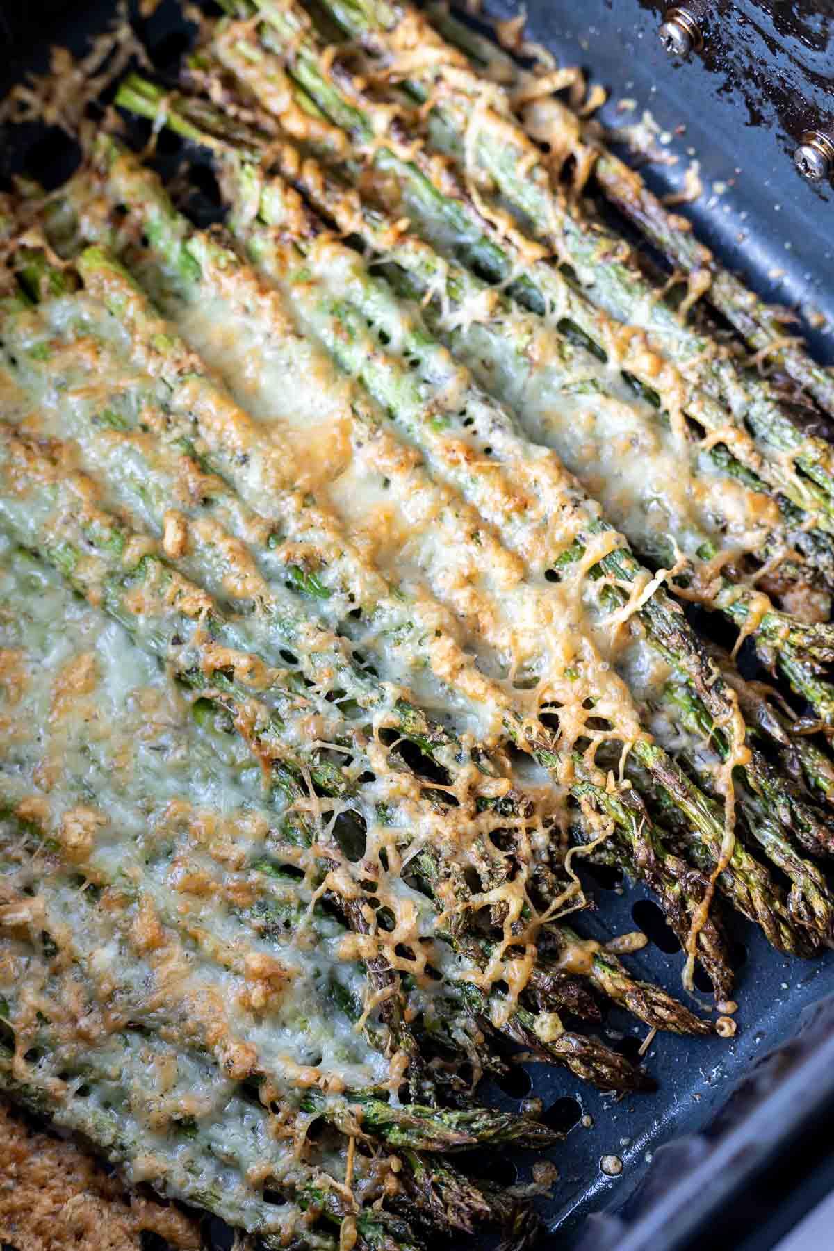 parmesan topped asparagus in air fryer basket