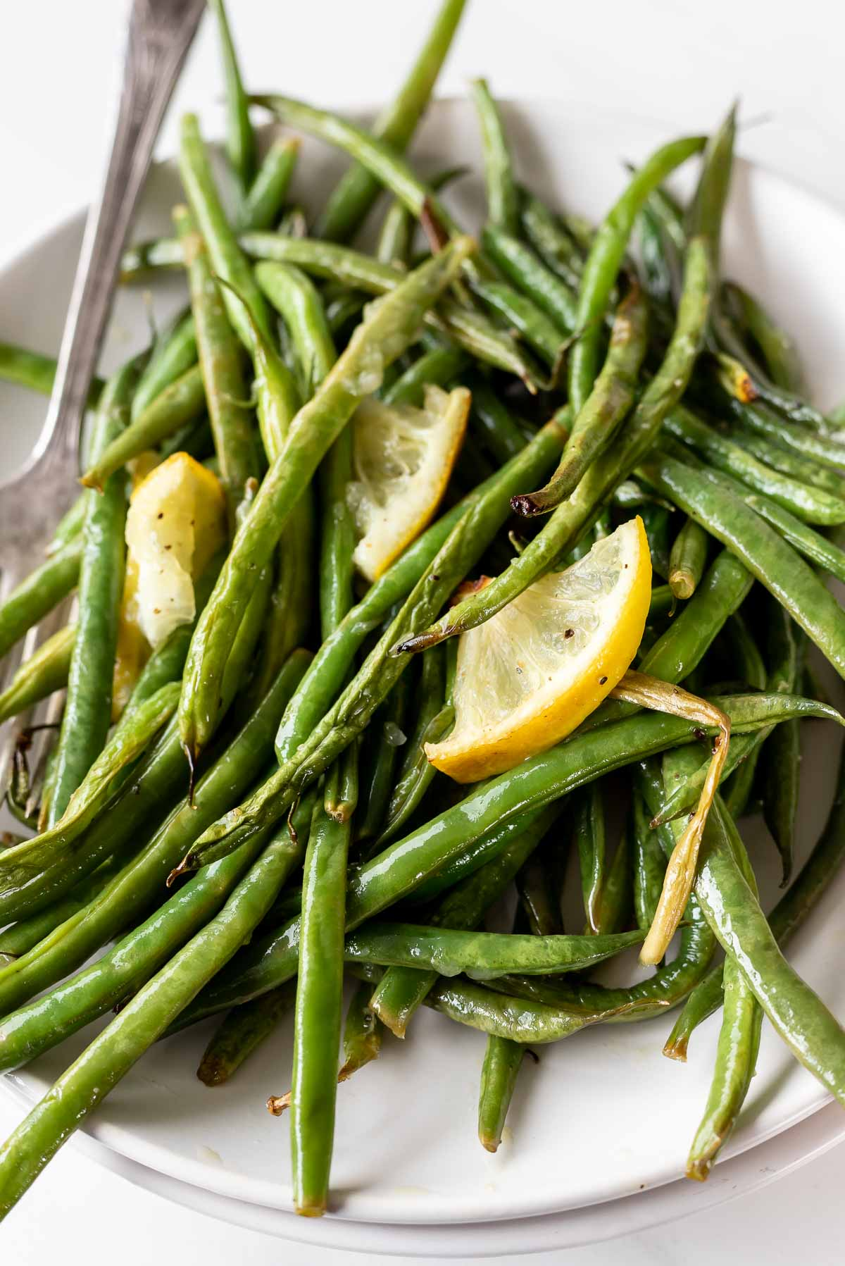 lemons and green beans served on white dish