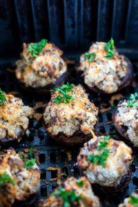 cooked stuffed mushrooms in air fryer basket