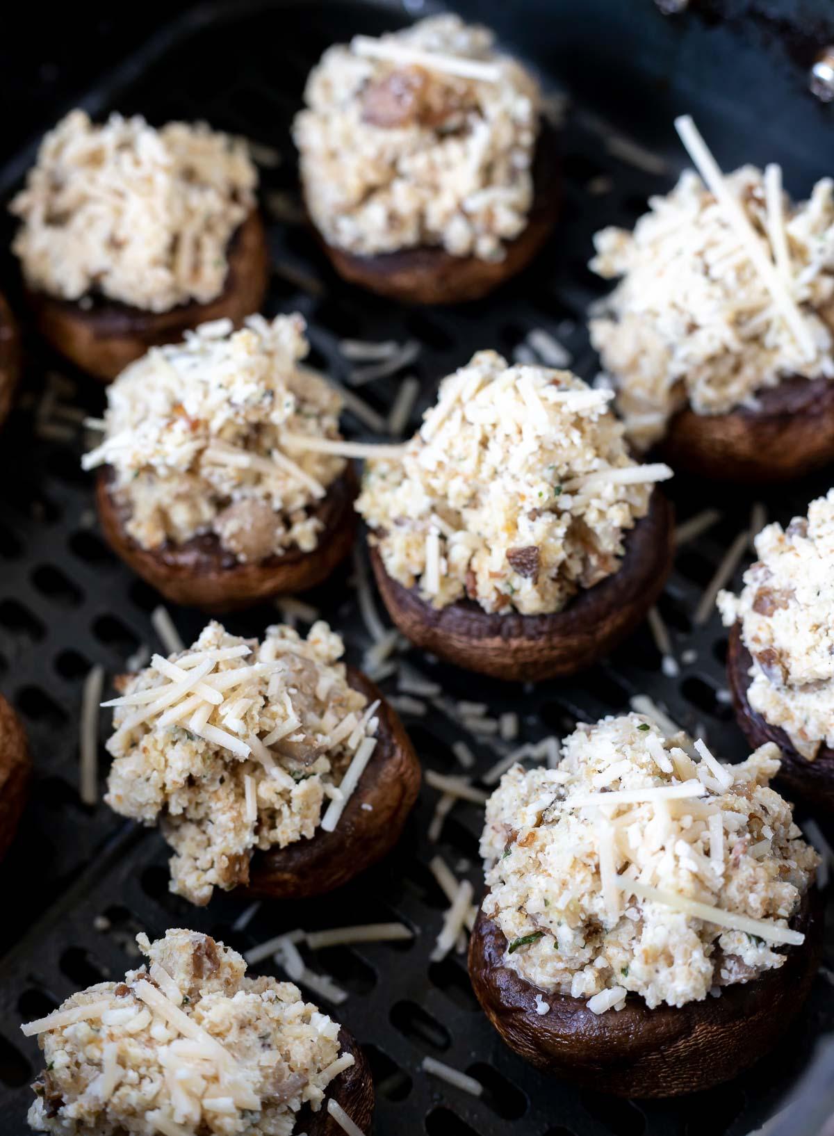 uncooked stuffed mushrooms in air fryer basket