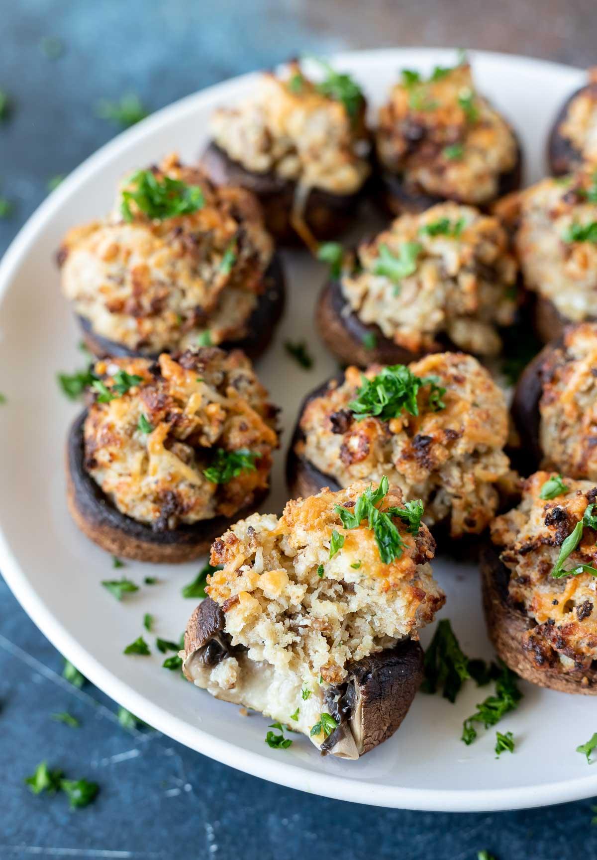 stuffed mushrooms on white plate
