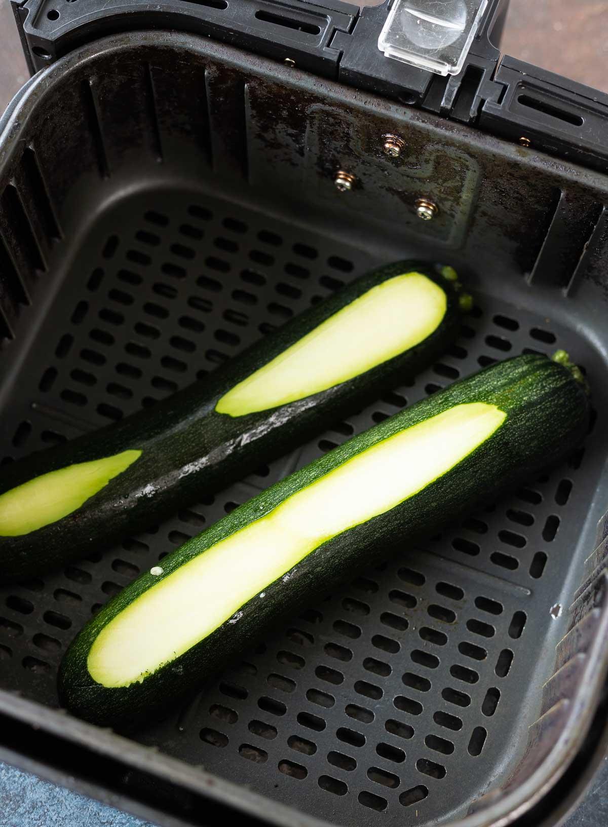 raw zucchini in air fryer basket