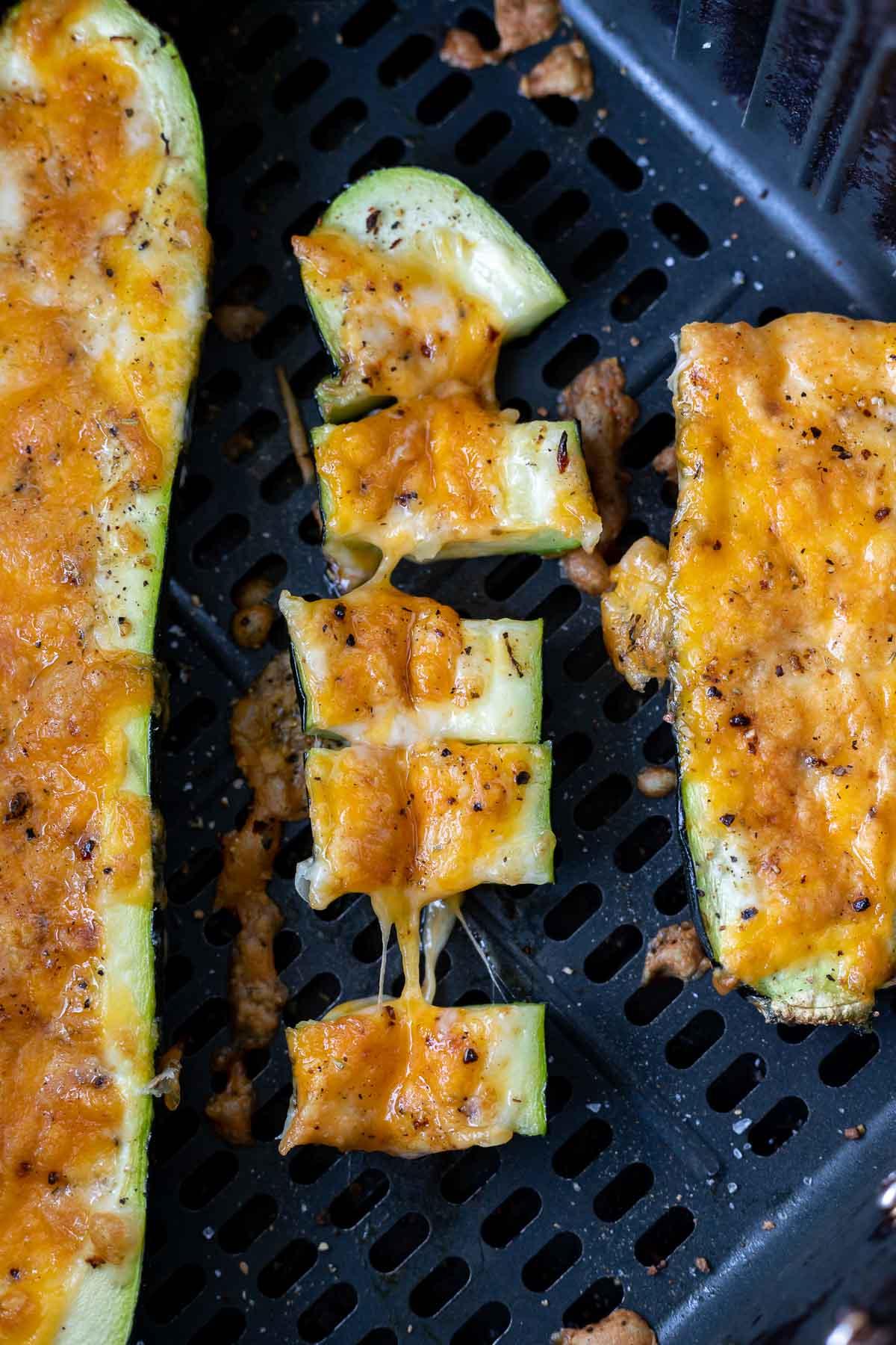 melty cheesy zucchini in air fryer basket
