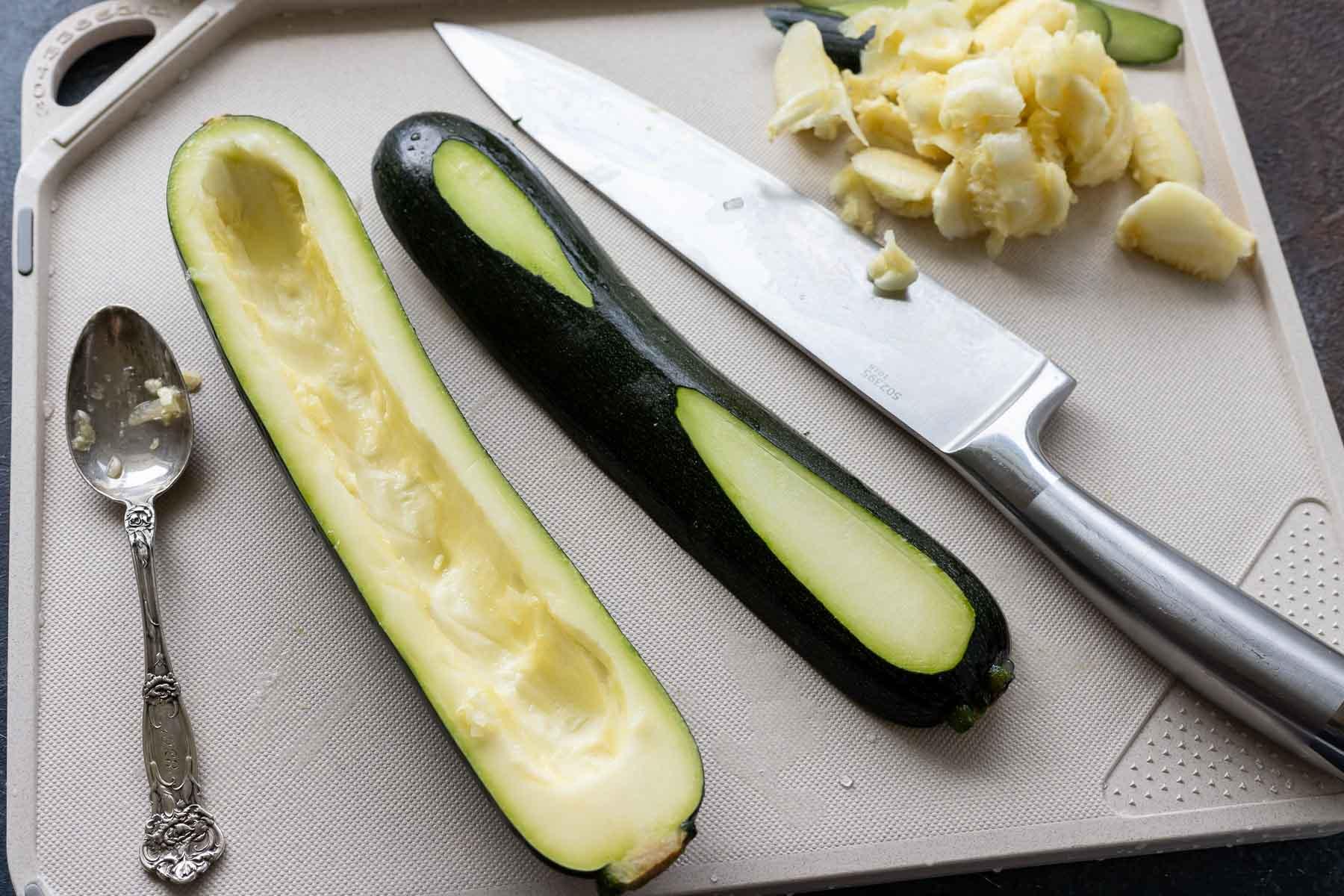 zucchini on cutting board next to knife